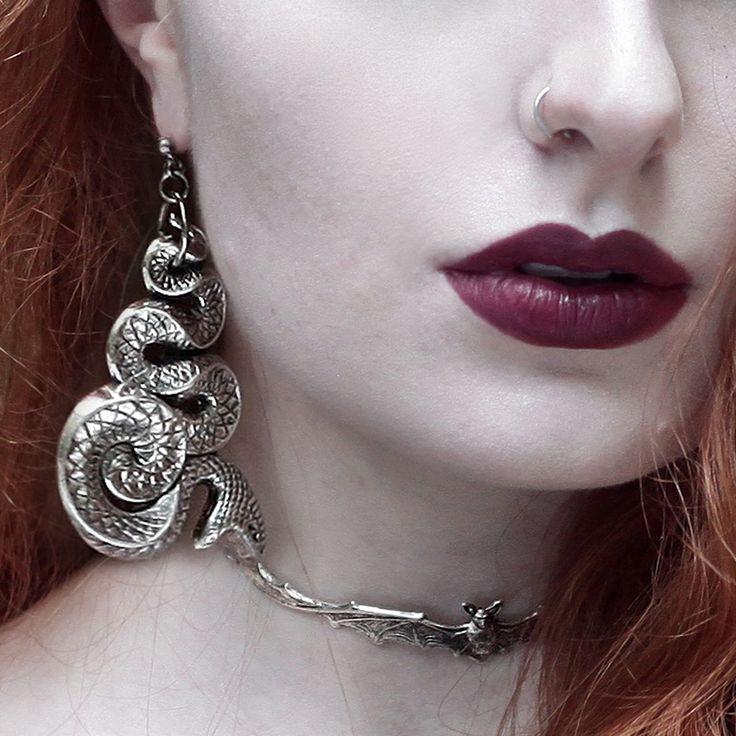 'Malice' chunky silver snake earrings & 'Lilith' bat wing choker. Worn and styled by Olivia Emily.   #halloween #spooky #snake #grunge #earrings #jewellery #snake #medusa