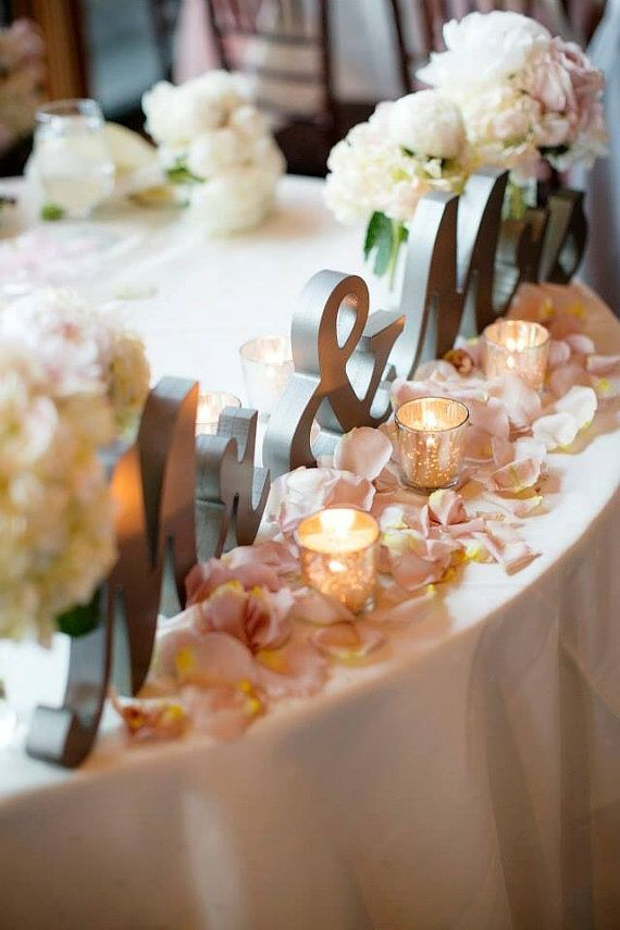 This is what I'd like our sweetheart table to look like. Though the church doesn't have a sweetheart shape; it'll just be a rectangle banquet table. If it's really long, Kendall (my MOH) and Chad (Best Man) can join us! I have the Mr. & Mrs. sign picked out already in an antique gold, and faux petals in blush and champagne.