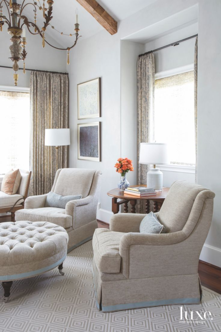 Blue Master Bedroom Sitting Area With Two Comfy Chairs And