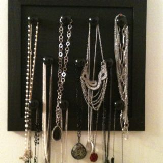 Homemade jewelry organizer! Spray painted old dresser knobs, cut foam board to size and put it in a frame