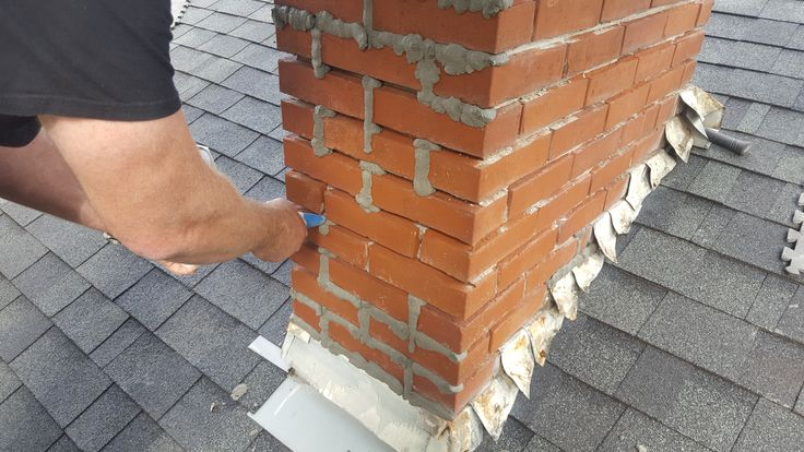 In this photo we are mid tuckpoint. The mason in the picture is pipping mortar into the mortar joints. This mortar was allowed to harden up a little bit after pipping and was then tooled to create new mortar joints.