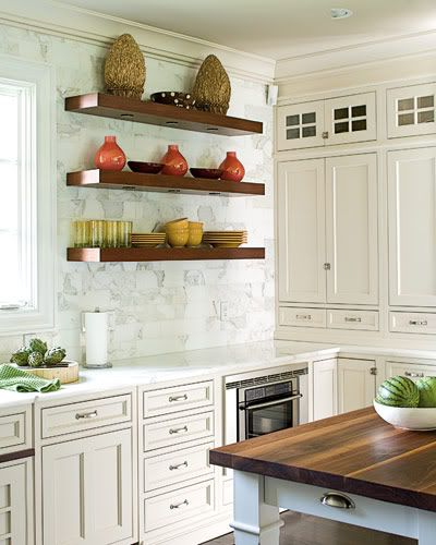 some exposed shelving plus upper cabinets to ceiling with glass panels.  Perfect for showing off or hiding!  (note, add lighting)