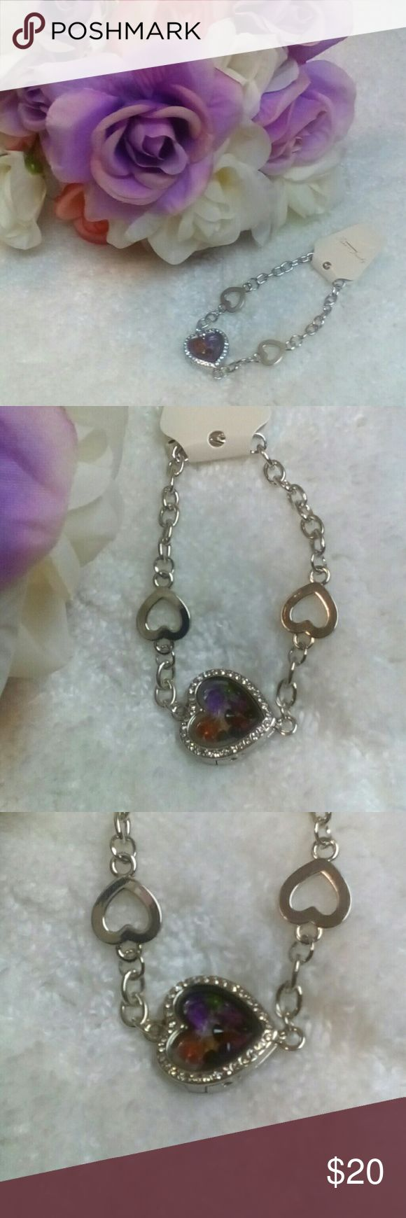 Silver Heart Living Memory Locket Bracelet It's brand new and cute. I didn't put any charms in it. Just gems.... different colors. I can add a charm or 2 of what u want. Just let me know. It's definitely precious to wear on ur wrist. Makes a wonderful gift as well. Jewelry Bracelets