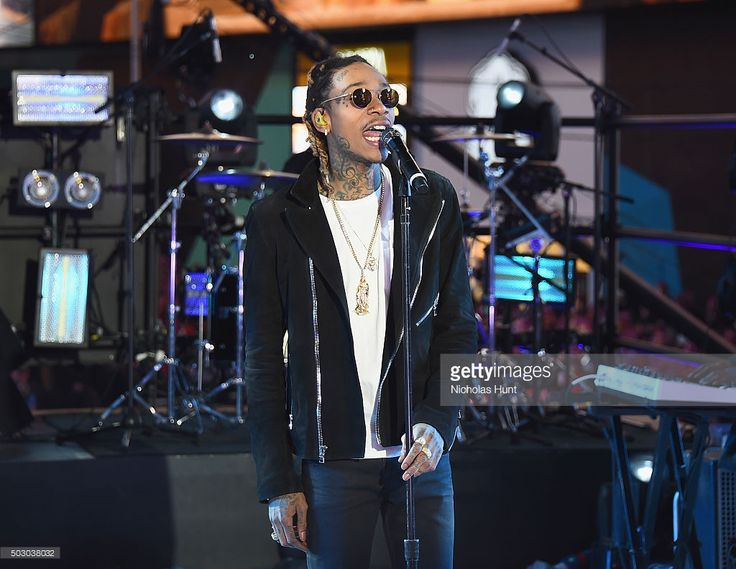 "Recording Artist Wiz Khalifa performs ""See You Again"" on stage with singer Charlie Puth at the Dick Clark's New Year's Rockin' Eve with Ryan Seacrest 2016 on December 31, 2015 in New York City."