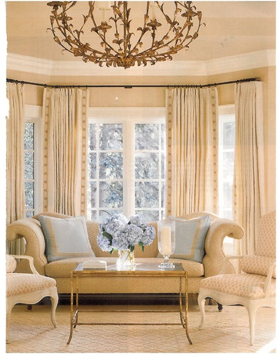 A Bright Sun Filled And Elegant Living Room Featuring Pierre Frey