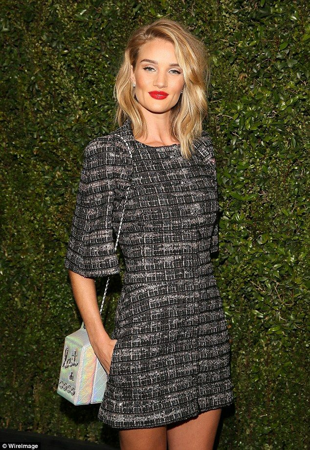 Adorable: Rosie Huntington-Whiteley looked sensational in a tweed minidress at the Chanel And Charles Finch Pre-Oscars Dinner, which took place at Madeo Restaurant in West Hollywood on Saturday