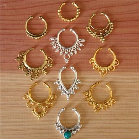 An assorted of my best selling silver ,brass and gold plated septums for a pierced nose    You will get 10 different designs with a value of $165 in