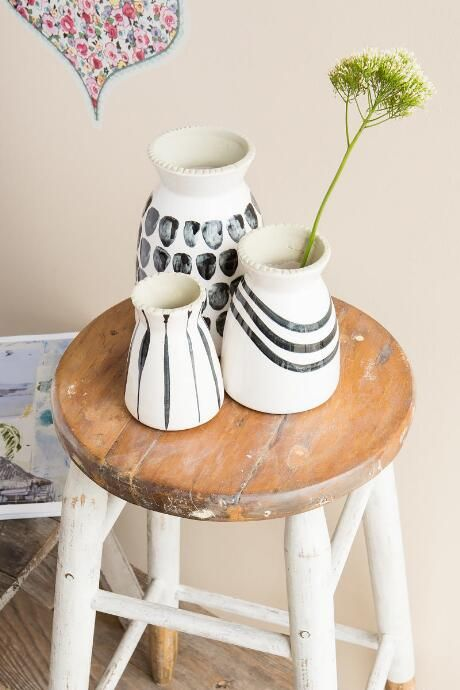 I need an old stool like this. And these black and white vases are cute, too!