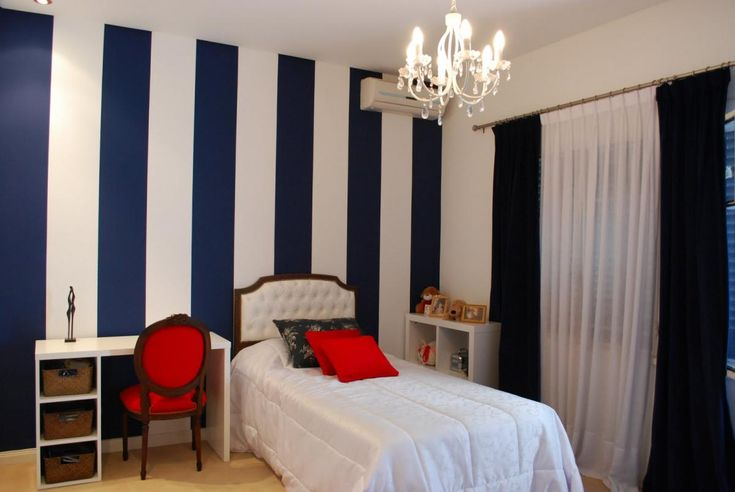 This blue/white vertical stripe look is  mirrored in the curtains. Stunning in contrasting colors or softer in monochromatic