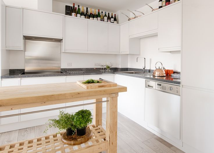 Professional chef Sven-Hanson Britt's clean, white kitchen features beautiful copper accents to complement his stainless steel integrated Miele appliances