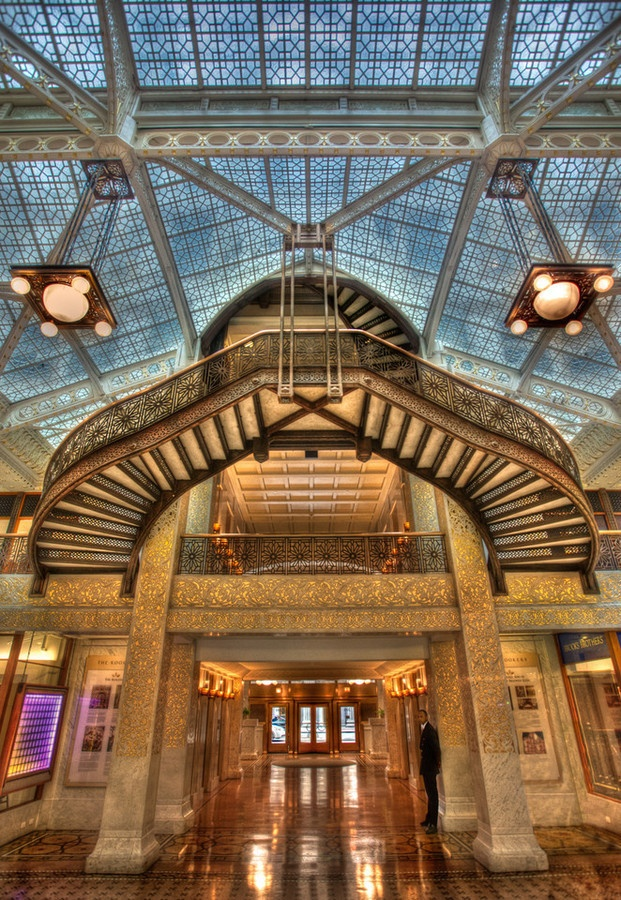 The Rookery in Chicago. Originally designed and built by Burnham and Root and the lobby remodeled by Frank Lloyd Wright in 1905. The right side of that right column shown in the picture is open to see the original darker design. http://en.wikipedia.org/wiki/Rookery_Building