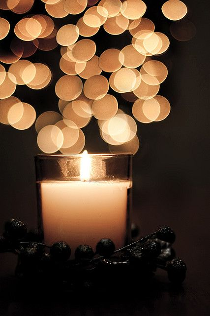 Candle bokeh by sztyui, via Flickr