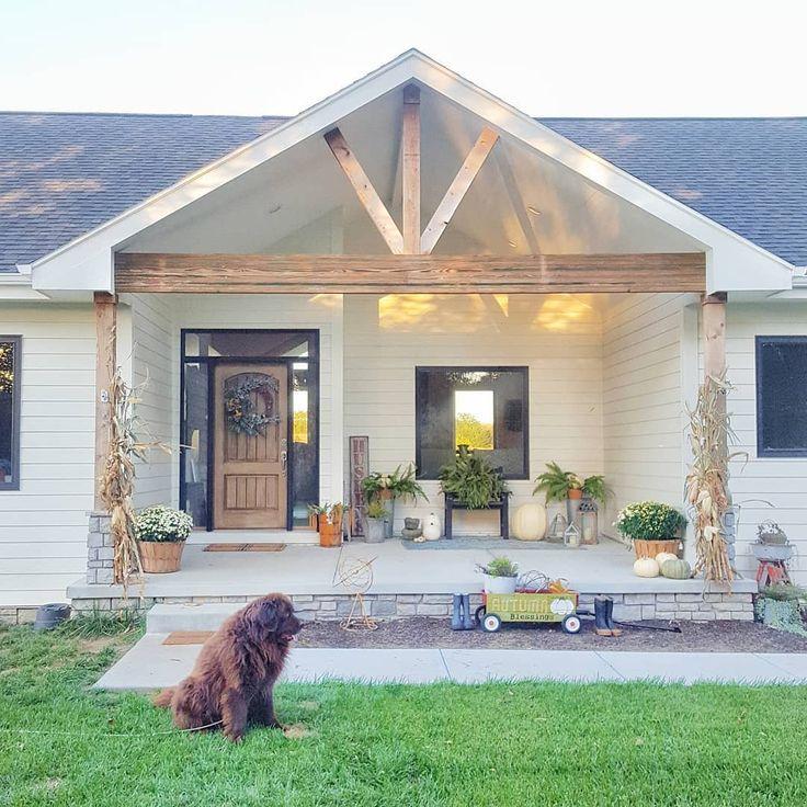 White ranch farmhouse fall front porch Newfoundland dog Wood beans Benjamin Moor…