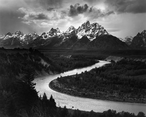 I am a fan of Ansel Adams. His photography of northern California is astonishing. I enjoy looking at landscape photography, especially in black and white form. The shades show the texture of the water and mountains behind.