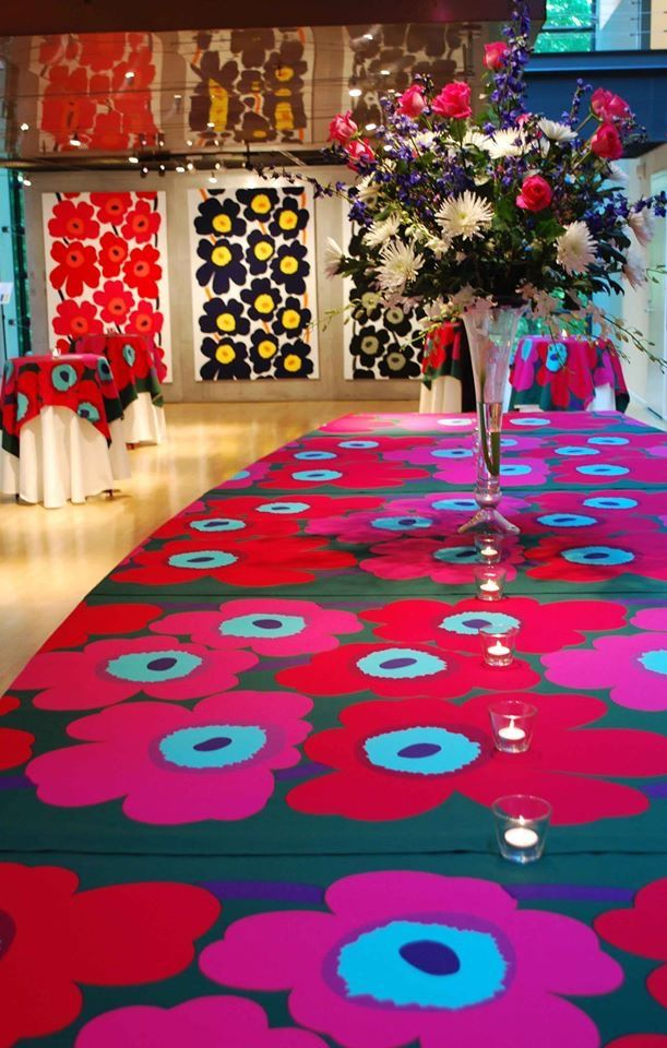This might be material, but a pattern painted table! Candles look lost, vase is… More