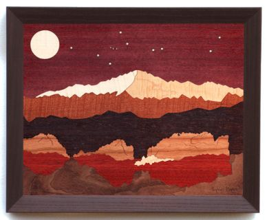 "Named for explorer Zebulon Pike, this majestic mountain graces the Colorado Springs skyline. The woods used in this scene are: Purpleheart, Sycamore, Curly Maple, Fiddleback Makore, Wenge, Cherry, Jarrah, Walnut Stump. Frame is ""Java"" Stained Red Oak.  ​Ship to U.S. only"