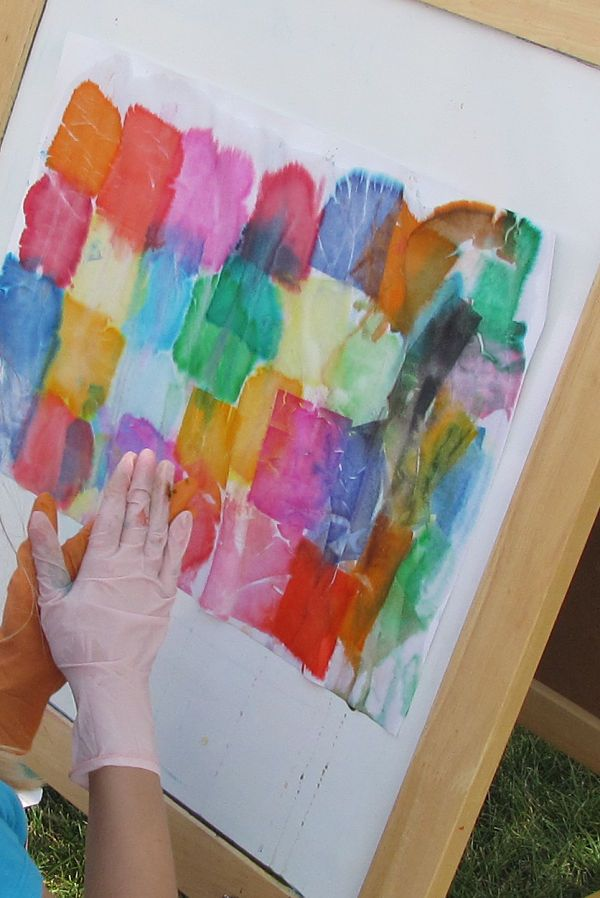 tissue paper squares (that bleed) on wet paper.  Spray with water. Pull tissue off after a few minutes.