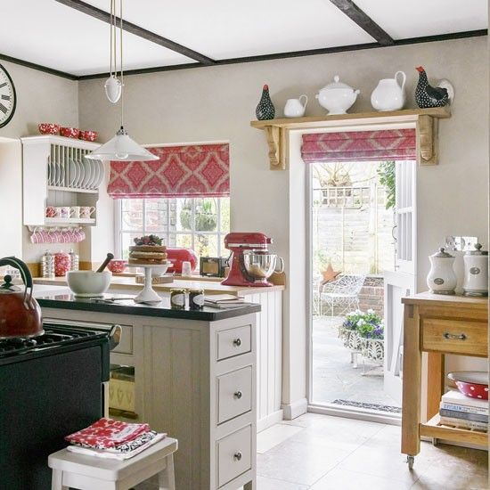 Lovely modern country Kitchen with red accents