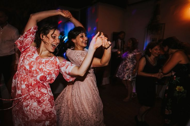 Time to grab a partner and dance until the sun comes up. Photo by Benjamin Stuart Photography #weddingphotography #weddingparty #dancing #disco #partner #weddingfun #letyourhairdown