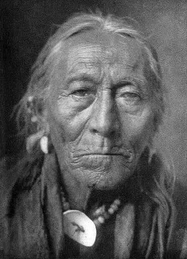 Hunts The Enemy (Ashpasha-fsidish) (1828-1907) - Apsaroke (Crow) - One of the greatest warriors and war-leaders of the tribe. He led nearly 30 successful war-parties in four of which he himself killed each time 2 Piegan (Sioux). - Photo by Edward S. Curtis - 1908 - (B/W copy)