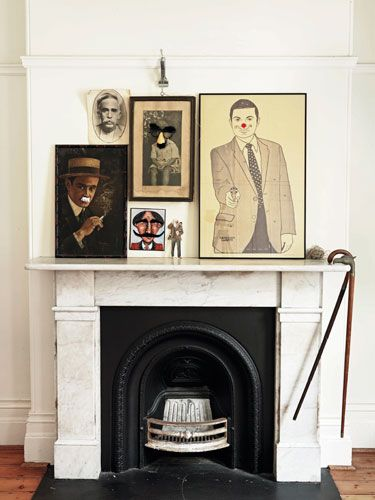 Add some light-hearted humor to your mantel by gathering various portraits of men and boys, like these  mustachioed men.