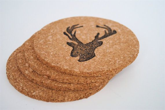 DIY idea: cork coasters from dollar store, hand stamp buck heads onto them.