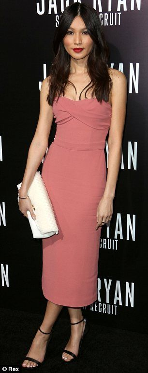Gemma Chan.. Burberry Prorsum Resort 2014 strapless dusty pink wrapped bodice crêpe dress, Burberry fold clutch, and a pair of slick bar ankle strap sandals..