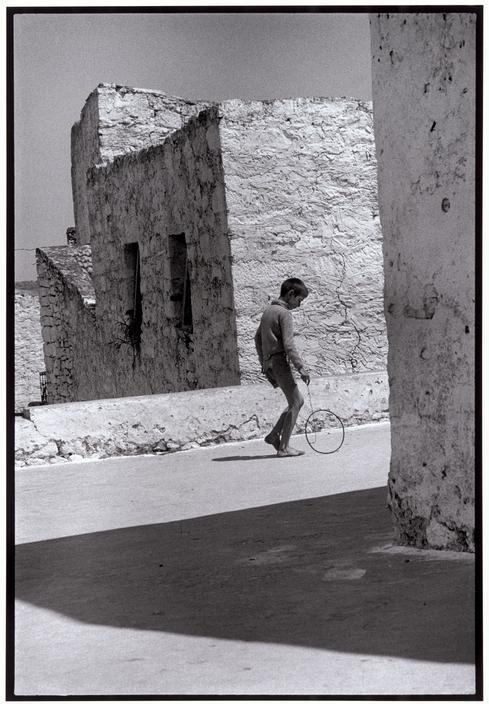 """© Constantine Manos/Magnum Photos Greece. Crete. 1964. Boy with a hoop. """"A Greek Portfolio"""" p.11"""