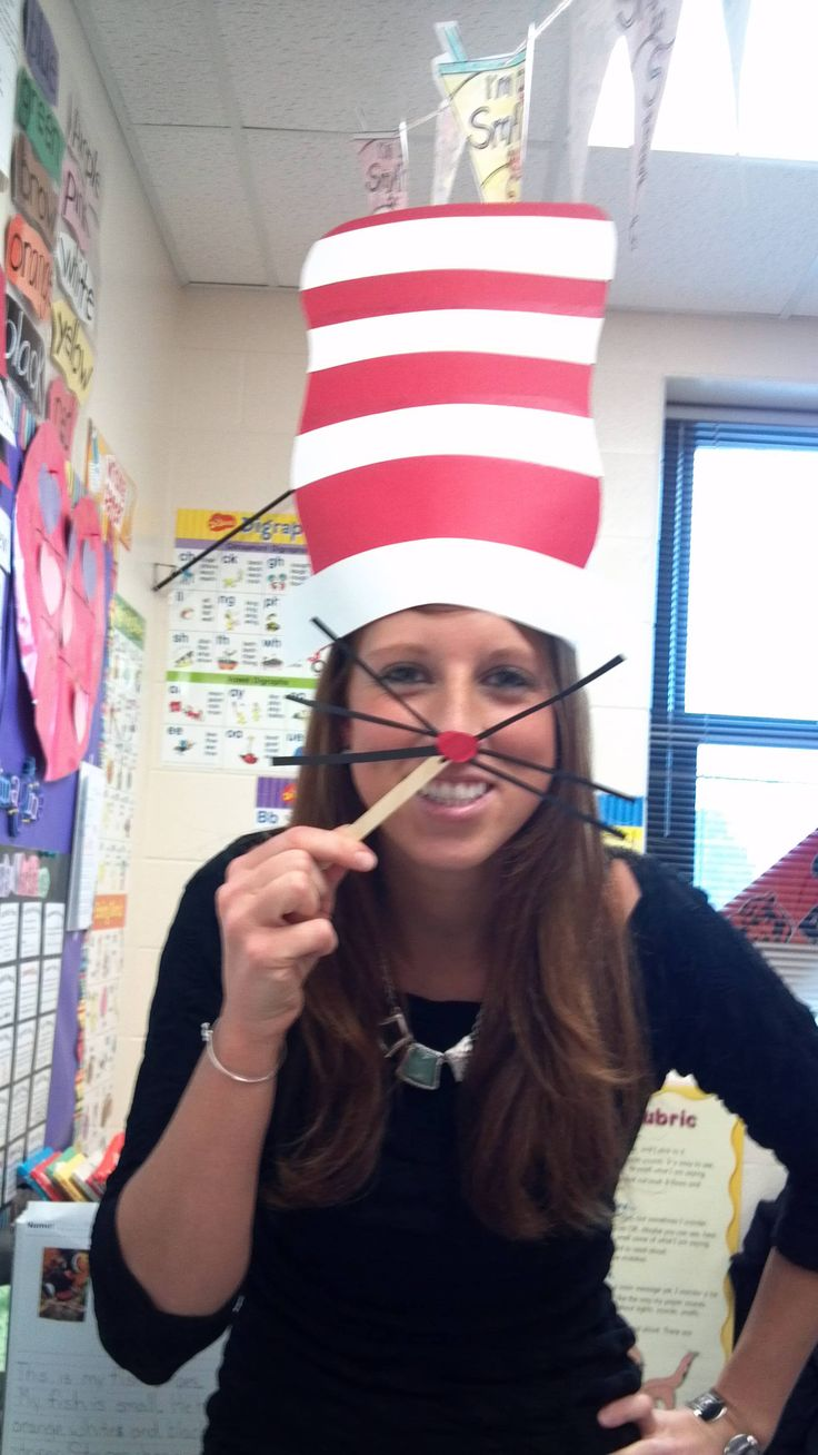 Whiskers and a nose on popsicle stick and hat on sentence strip for Dr Seuss week!