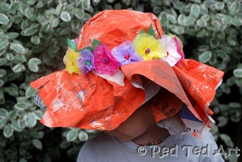 Making fancy Easter hats out of newspaper, masking tape and paint.  Lots of fun for the kids.