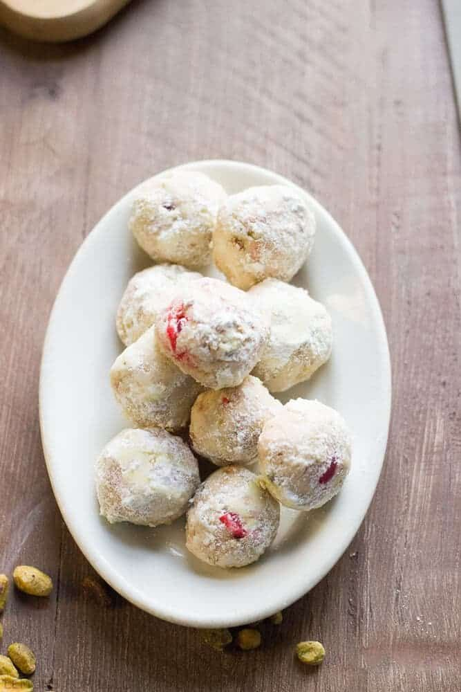 Snowball cookies are a Christmas classic, but this recipe dresses them up fancy. Pistachio nuts and maraschino cherries bring a festive touch. Recipe here!