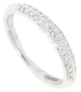 Approximately .23 carats total weight of diamonds is set in this 14K white gold antique style wedding band. The double row of diamonds covers the top 1/3 of the circumference of the ring. A slightly ridge separates the rows of diamonds. The ring measures 3.4mm in width. Size: 7. We can re-size.