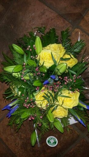 Rustic posy of Latina roses, tiger lily, iris and pepper berry, smells wonderful!
