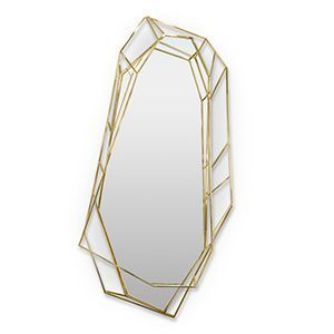 Diamond is a full length version of the diamond shaped mirror, covering about 70 inches of the wall. Since it is crafted in a polished brass structure it produces a tall sleek design, merging geometry and design on the same object.