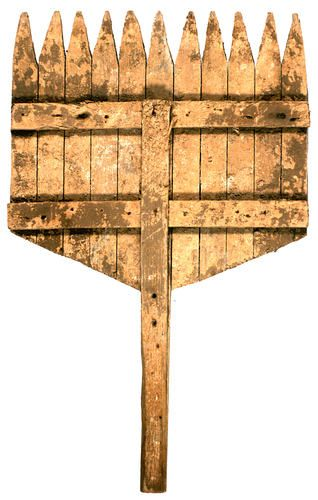 Wooden plaster spreader circa 1900 used in a mental health hospital in Beechworth Victoria Australia. Possibly used in conjunction with the plasterer's bucket (750.3) to spread plaster, perhaps on a wattle and daub surface.