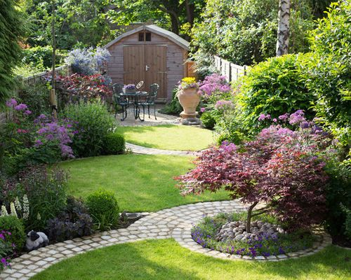 Our client's garden was bereft of any interest, other than a large shed at the end of the garden, and a small patio outside the house. An unattractive stand of conifers dominated one side of the
