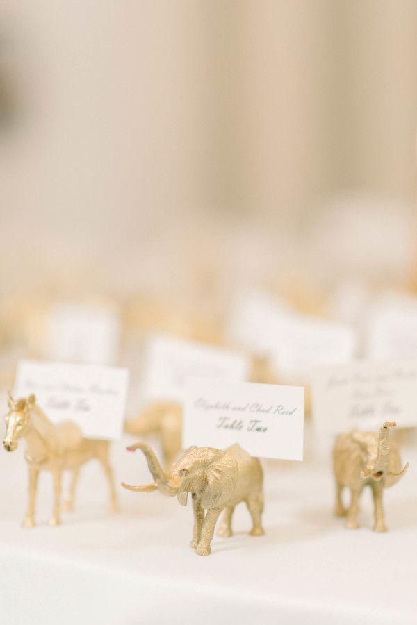 Gold animal escort cards: http://www.stylemepretty.com/washington-dc-weddings/2016/03/07/classic-black-white-d-c-wedding-ballroom-wedding-with-pops-of-pink/   Photography: Elizabeth Fogarty - http://www.elizabethfogartyphotography.com/