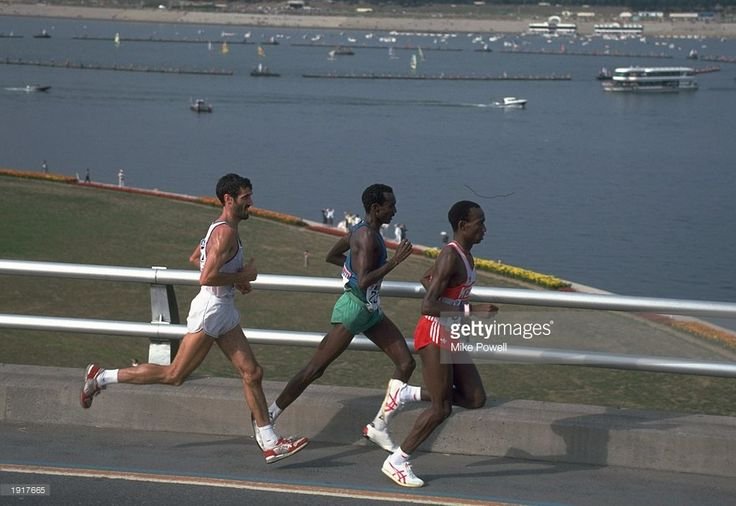 Gelindo Bordin (left) of Italy Ahmed Salah (centre) of Djibouti and Douglas Wakihuri (right) of Kenya in action during the Marathon event at the 1988 Olympic Games in Seoul, South Korea. \ Bordin won the gold medal, Wakihuri won the silver and Salah won the bronze medal in this event. \ Mandatory Credit: Mike Powell/Allsport