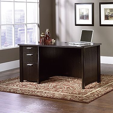 """The durable, 1"""" thick top makes our computer desk both attractive and functional.  The drawers can be fastened on the left or right side to make it easier for you to store belongings.  The lower drawer on our computer desks feature full extension slides to hold letter or European size hanging files.  Quick and easy assembly with patented T-lock drawer system.  Also includes a grommet hole for cord management.  Wind Oak finish."""