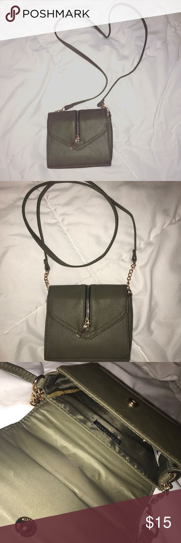 """🥀{Atmosphere} Navy green crossbody 🥀 NWOT Very cute with dainty chain details on the strap, and zipper detail on the front of the bag. Would fit money, phone, lipgloss. All the essentials for a quick errand or a night out. ▪️Atmosphere ▪️6""""W x 6""""H x 1""""D ▪️Perfect for a night on the town   🥀Add any item(s) into a bundle for a private offer🥀 Atmosphere Bags Crossbody Bags"""