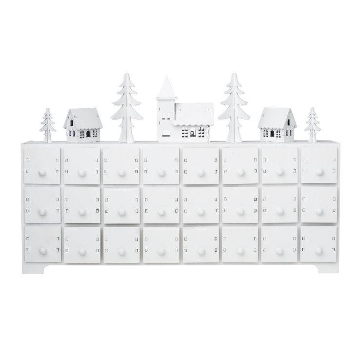 """Minibyrå vit, fint """"adventskalenderhus"""" av trä med ljusby och 24 lådor. LED belysning (batteri medföljer ej: 2xAA 1,5V). Byrå: 45x18,5 cm, djup 8 cm. Lådornas innermått: 39x39x47 mm."""