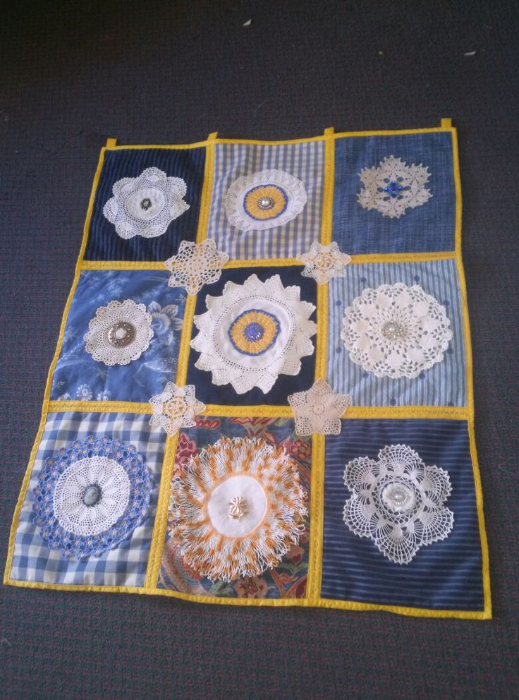 Doily quilt hanging made from vintage doilies and vintage pins. I used a Quilt as you go technique.