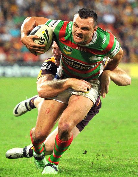 Beau Champion of the Rabbitohs attempts to break away from the defence during the round eight #NRL match between the Brisbane Broncos and the South Sydney Rabbitohs at Suncorp Stadium on May 3, 2013 in Brisbane, Australia.