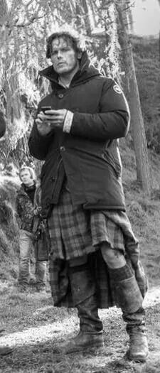 Sam Heughan a behind the scenes shot .  I love him when he's all dirty!!!! ;-)