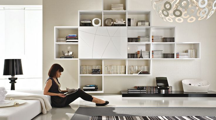 Horizon bookcase by Mobil Gam. Free combinations, a design that breaks volumes down with radical interventions: it opens to unusual shapes, it empties looking for architectural perfection and become simpler looking for maximum compositional neatness. TOGNIN ARREDAMENTI authorized dealer.