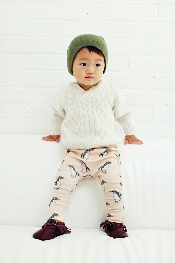 this penguin print is uniquely designed exclusively for Our Little Lullaby , and made with the softest fabric for your little one's delicate and sensitive skin.these leggings are 100% USA grown GOTS certified organic cotton, the highest quality organic material with no harmful chemicals. we offer a high quality braided elastic waistband to stretch with your growing little ones.please note that all your leggings are handmade and unique, pattern placements may vary slightly fr...