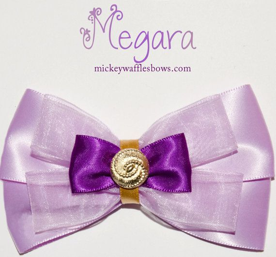 A medium (approx. 4 inches) hair bow inspired by the sassy Megara from Disneys Hercules.    Choose your clip type using the drop down menu above