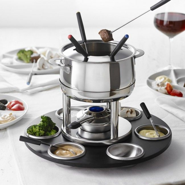The sleek design of this Nouba stainless steel meat fondue set makes it the perfect centrepiece for any meal. It comes with a convenient rotating board for easy access for all guests . The stainless steel dishes hold a variety of foods on the lazy susan. This set is ideal for a meat fondue. Family and friends can quickly select and spear what they'd like to dip.