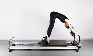 Groupon - Reformer Pilates Sessions at Baker Chiropractic - Pilates (Up to 70% Off). Six Options Available in West Los Angeles. Groupon deal price: $75