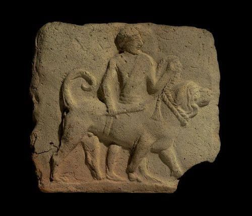 Terracotta plaque of a man leading a dog Old Babylonian 2000-1600 BCE from Borsippa - Iraq